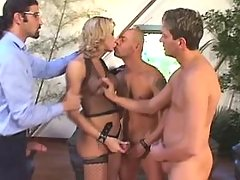 Tranny in fishnet wear in wild orgy