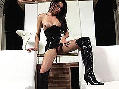Stunning tgirl in black latex